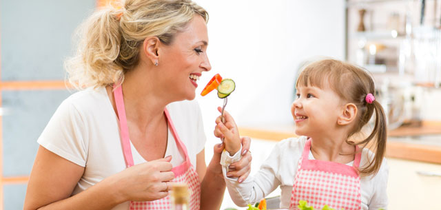 picture of mother and daughter eating health food