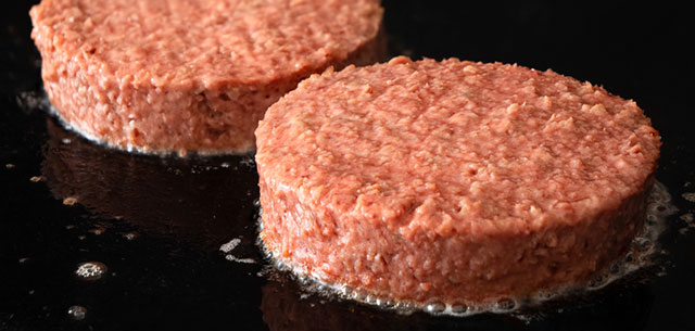 picture of plant-based burgers on grill