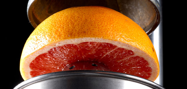 photo of grapefruit under pressure