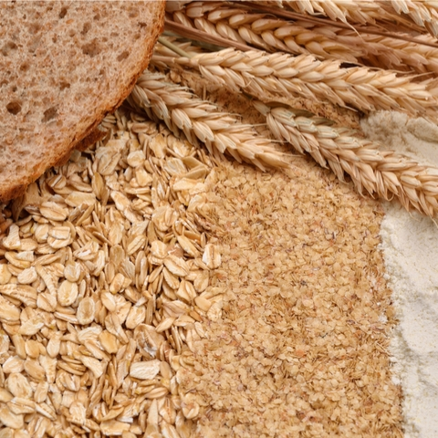 Picture of a bread and different type of grains