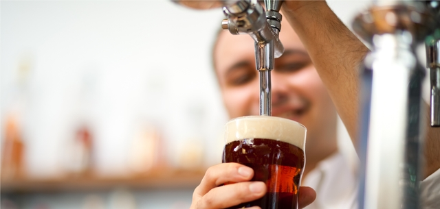 picture of man pouring a pint
